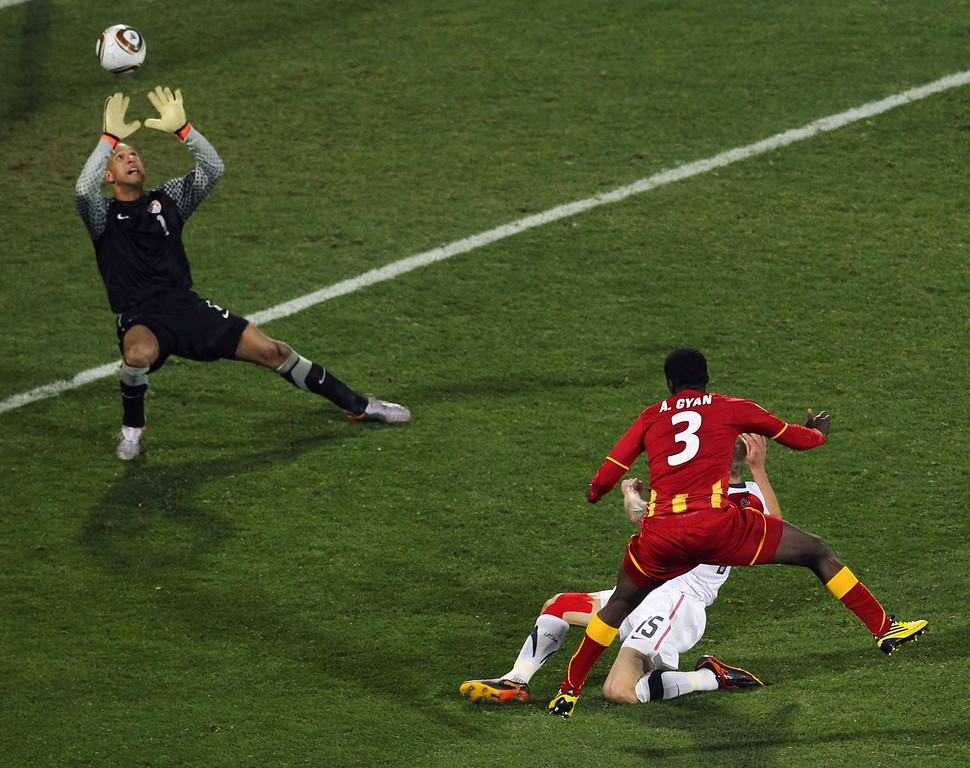 . Ghana\'s Asamoah Gyan, bottom right, scores his side\'s 2nd goal past United States goalkeeper Tim Howard, top, during the World Cup round of 16 soccer match between the United States and Ghana at Royal Bafokeng Stadium in Rustenburg, South Africa, on Saturday, June 26, 2010.  (AP Photo/Themba Hadebe)