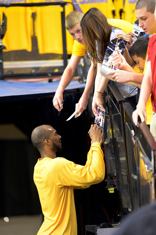 . Corey Brewer (13) of the Denver Nuggets signs autographs for fans after pre game warmups before their game agains the Golden State Warriors in Game 6 of the first round NBA Playoffs May 2, 2013 at Oracle Arena. (Photo By John Leyba/The Denver Post)