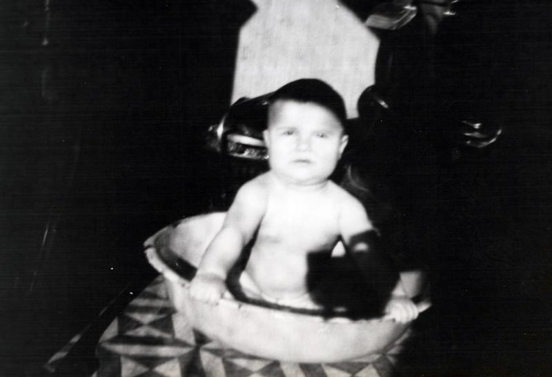 1925 Donald Konyha in bath inside the house.jpeg