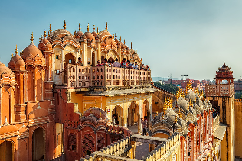 JAIPUR, INDIA - NOVEMBER 18, 2012: Tourist visiting Hawa Mahal palace (Palace of the Winds) famous Rajasthan tourism landmark