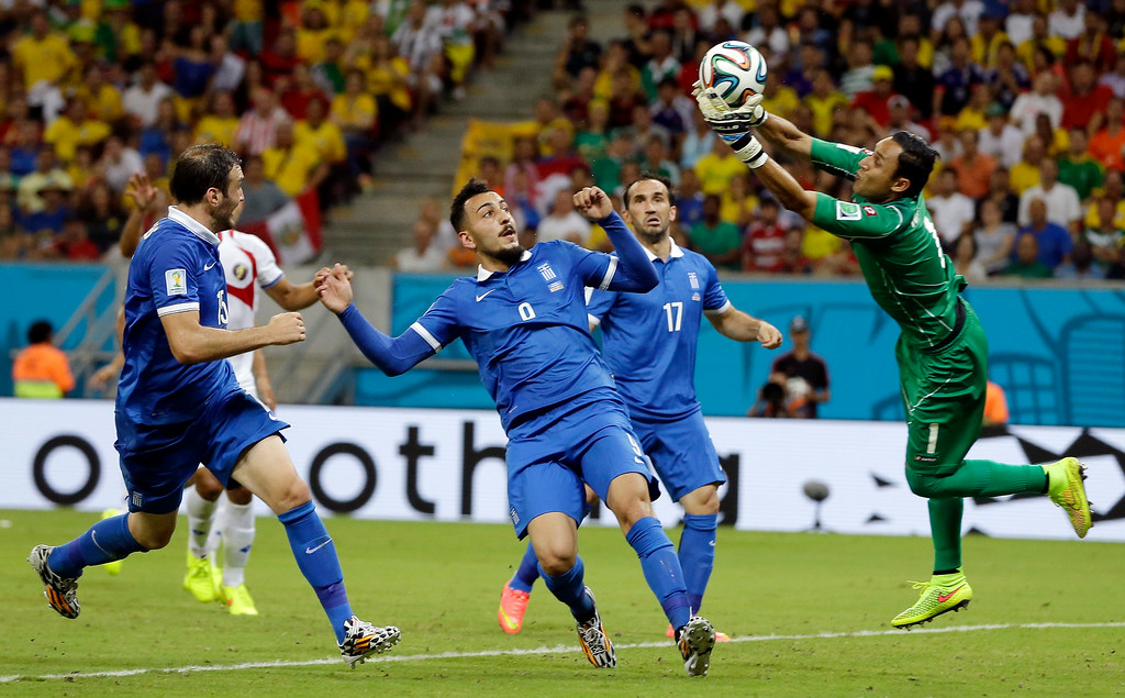 . Costa Rica\'s goalkeeper Keylor Navas, right, makes a save during the World Cup round of 16 soccer match between Costa Rica and Greece at the Arena Pernambuco in Recife, Brazil, Sunday, June 29, 2014. (AP Photo/Ricardo Mazalan)