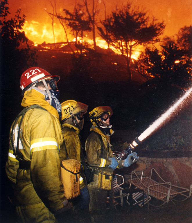 . Firefighters battle a house fire in the Malibu area.    (11/2/93)   Los Angeles Daily News file photo