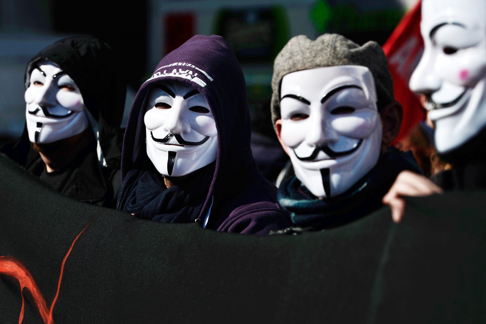 . Wearing Guy Fawkes masks, demonstrators take part in a march on February 20, 2013 in Athens, during a 24-hours general strike called by leading unions against unrelenting austerity in the recession-weary nation ahead of an audit by international creditors, disrupting flights, ferries and hospital services. The strike, the first general work stoppage in debt-crippled Greece this year, has forced airport authorities to sscrap or reschedule dozens of flights while hospitals were operating on reduced staffing.   ARIS MESSINIS/AFP/Getty Images