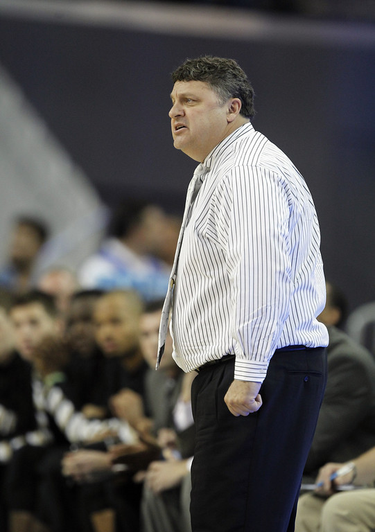 . Oakland head coach Greg Kampe on the sidelines in the first half of their NCAA college basketball game against UCLA Tuesday, Nov. 12, 2013, in Los Angeles. (AP Photo/Alex Gallardo)
