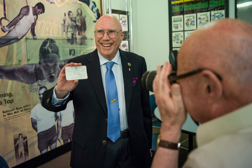 . LA Valley College\'s first student, Lloyd Jones, shows off his original student card from 1949.  The world renowned aviation artist was invited back to campus for a Deans reception.  Photo by David Crane/Los Angeles Daily News.