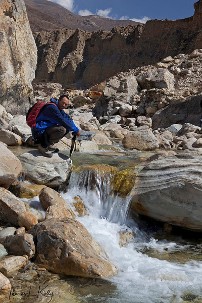Crossing fresh water stream on the way to Lo Manthang from Lo Ghyekar. Mustang, Nepal.
