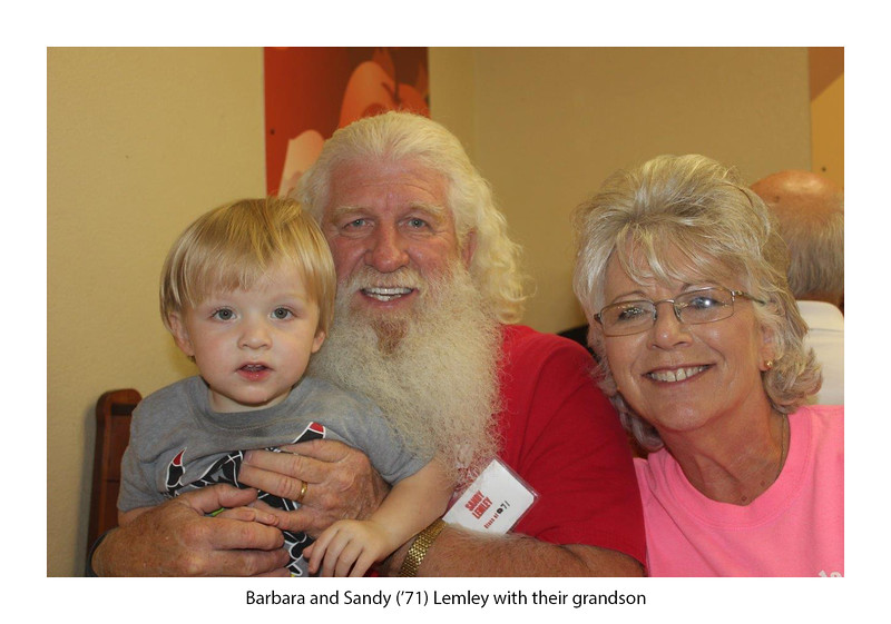 Barbara and Sandy Lemley '71 with their grandson.jpg