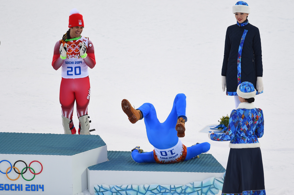 . Switzerland\'s gold medalist Sandro Viletta (L) applauds as Italy\'s silver medalist Christof Innerhofer celebrates during the Men\'s Alpine Skiing Super Combined Flower Ceremony at the Rosa Khutor Alpine Center during the Sochi Winter Olympics on February 14, 2014.  (FABRICE COFFRINI/AFP/Getty Images)