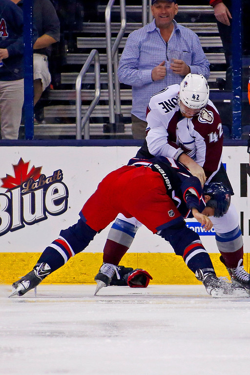 . COLUMBUS, OH - APRIL 1:  Derek Mackenzie #24 of the Columbus Blue Jackets is held down while fighting Brad Malone #42 of the Colorado Avalanche during the first period on April 1, 2014 at Nationwide Arena in Columbus, Ohio. (Photo by Kirk Irwin/Getty Images)