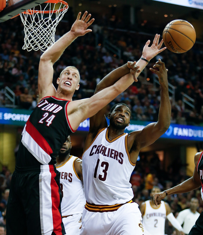 . Portland Trail Blazers\' Mason Plumlee (24) and Cleveland Cavaliers\' Tristan Thompson (13) battle for a rebound during the second half of an NBA basketball game Wednesday, Nov. 23, 2016, in Cleveland. The Cavaliers won 137-125. (AP Photo/Ron Schwane)