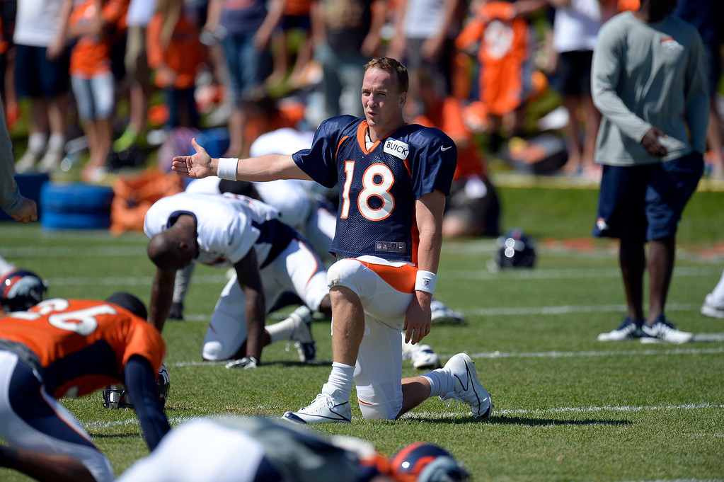 . Denver Broncos QB Peyton Manning (18)stretches during training camp August 5, 2013 at Dove Valley. (Photo By John Leyba/The Denver Post)