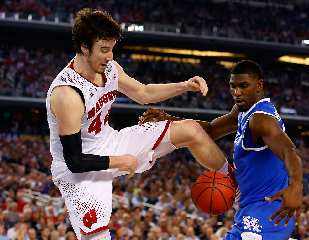. ARLINGTON, TX - APRIL 05:  Frank Kaminsky #44 of the Wisconsin Badgers and Alex Poythress #22 of the Kentucky Wildcats fight for a loose ball during the NCAA Men\'s Final Four Semifinal at AT&T Stadium on April 5, 2014 in Arlington, Texas.  (Photo by Tom Pennington/Getty Images)