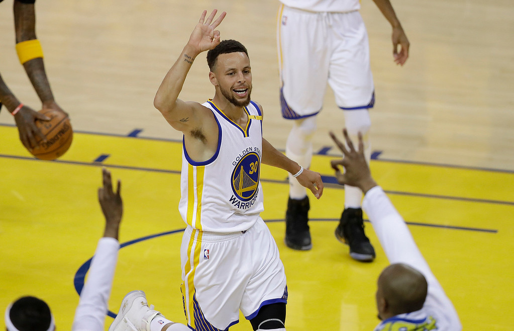 . Golden State Warriors guard Stephen Curry (30) gestures after scoring against the Cleveland Cavaliers during the first half of Game 2 of basketball\'s NBA Finals in Oakland, Calif., Sunday, June 4, 2017. (AP Photo/Marcio Jose Sanchez)