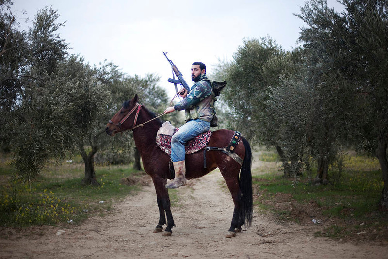 . A portrait of a Free Syrian Army rebel mounted of his steed in Al-Shatouria village near to the Turkish border in northwestern Syria, on March 16, 2012, a year after a revolt against President Bashar al-Assad\'s regime erupted. AFP PHOTO/GIOGOS Moutafis/AFP/Getty Images