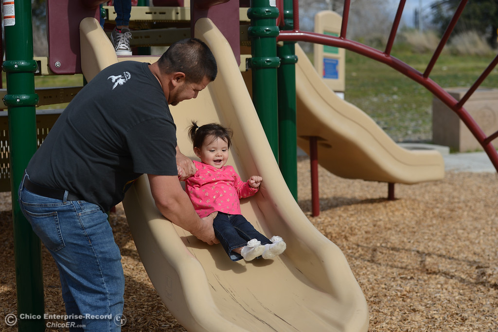 . Jacob Duran helps his daughter, Lia, down a slide in Riverbend park, Thursday, March 8, 2018, in Oroville, California. (Carin Dorghalli -- Enterprise-Record)