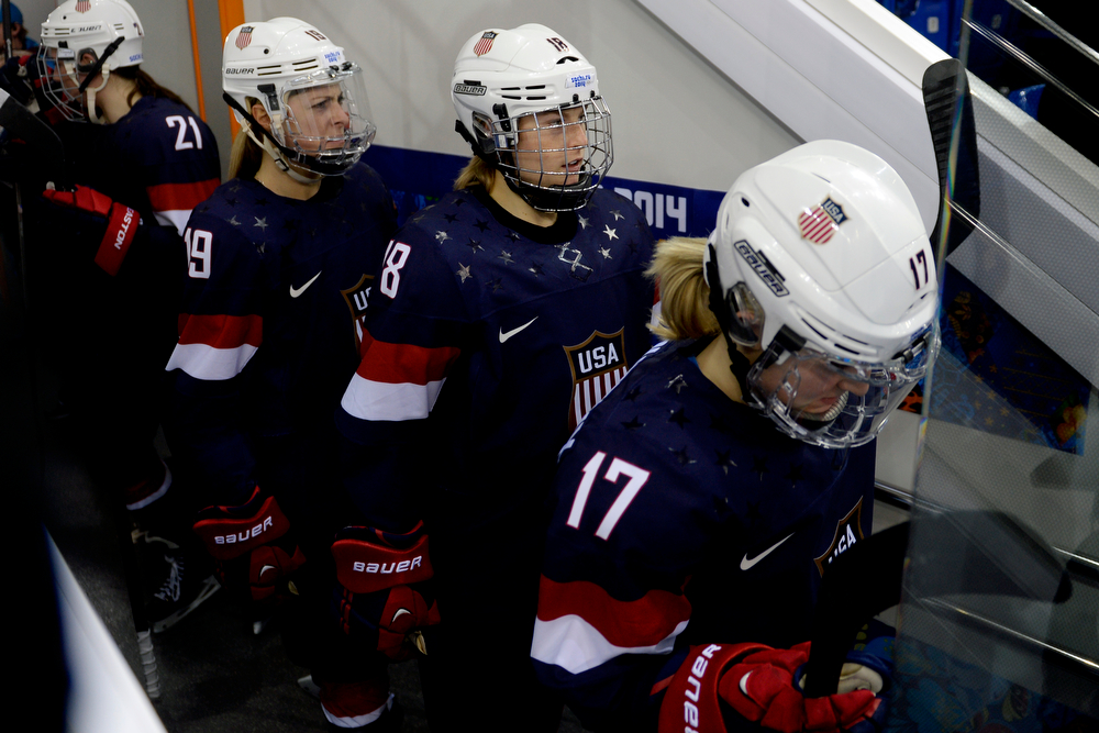 . U.S.A. hockey players Jocelyne Lamoureaux (17), Lyndsey Fry (18) and Gigi Marvin (19) prepare to take the ice before the third period of the United States\' 3-1 win against Finland. Sochi 2014 Winter Olympics on Saturday, February 8, 2014. (Photo by AAron Ontiveroz/The Denver Post)