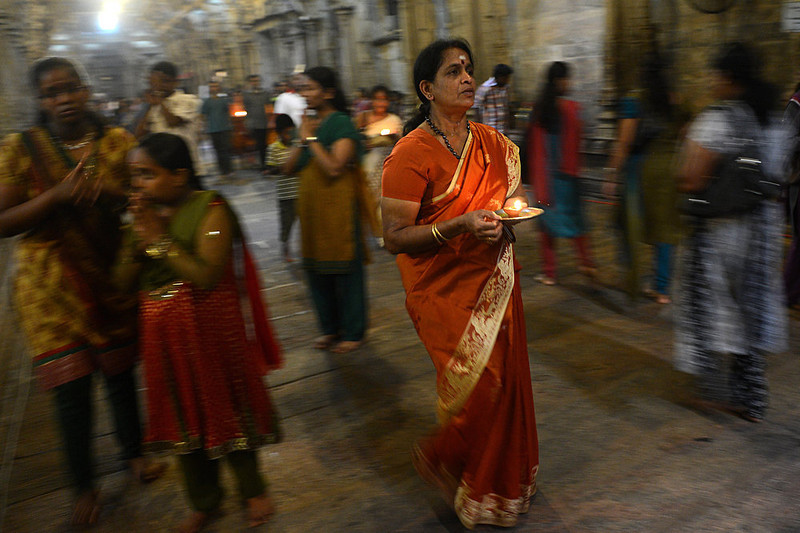 . A Sri Lankan Hindu devotee offers prayers while holding an oil lamp during the Maha Shivaratri festival at a temple in Colombo on March 10, 2013. The festival of Maha Shivaratri is marked by Hindus fasting and offering prayers in a night long vigil. Ishara S. Kodikara/AFP/Getty Images