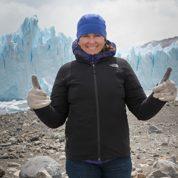 Smiling woman showing thumbs up on Perito Moreno Glacier, Los Glaciares National Park, Santa Cruz Province, Patagonia, Argentina