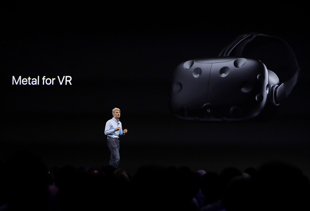 . Craig Federighi, Apple\'s senior vice president of software engineering, speaks about virtual reality during an announcement of new products at the Apple Worldwide Developers Conference in San Jose, Calif., Monday, June 5, 2017. (AP Photo/Marcio Jose Sanchez)