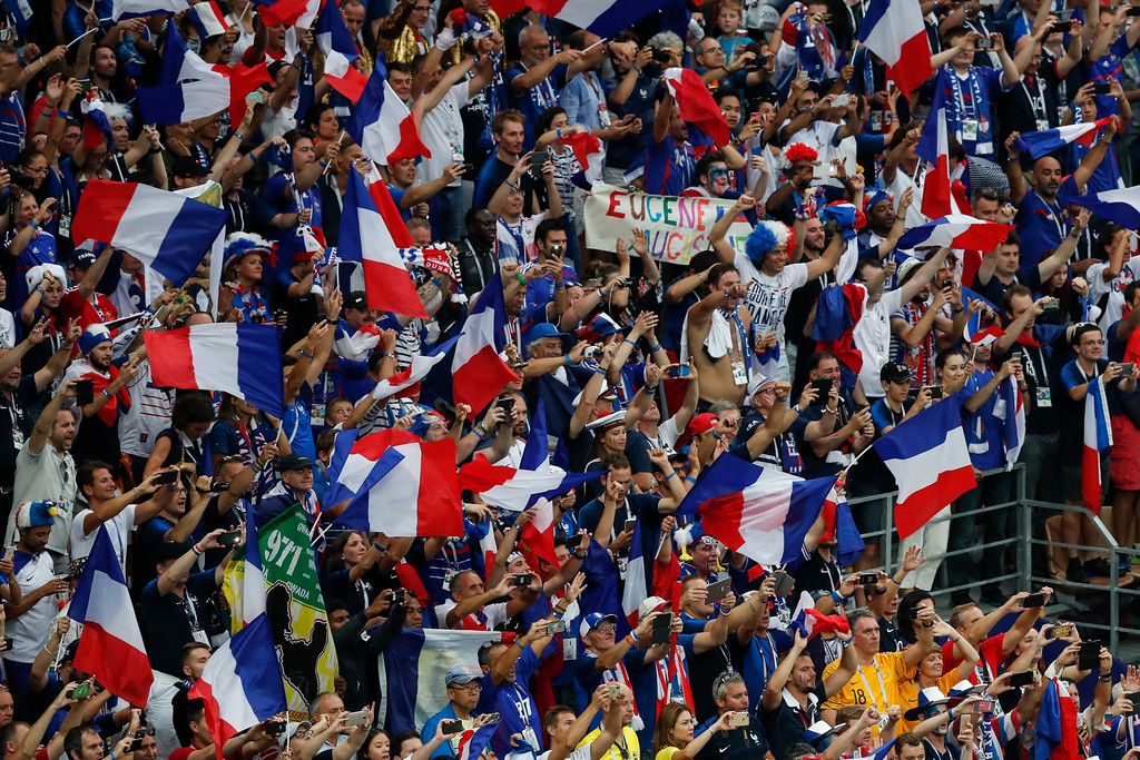 . France soccer fans cheer at the end of the final match between France and Croatia at the 2018 soccer World Cup in the Luzhniki Stadium in Moscow, Russia, Sunday, July 15, 2018. (AP Photo/Rebecca Blackwell)