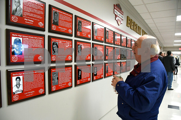 2/3/2018 Mike Orazzi | Staff Fran Rio looks over some of the plaques on display for the new home of the Berlin High School Hall of Fame inside the newly renovated Berlin High School on Saturday.