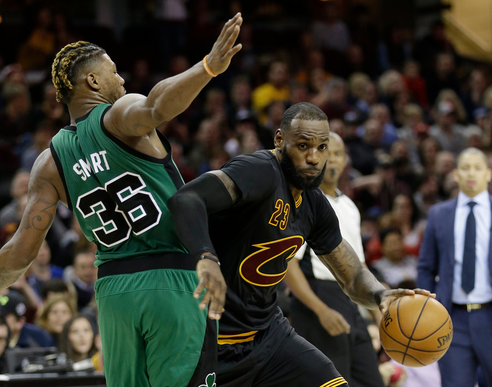. Cleveland Cavaliers\' LeBron James, right, drives against Boston Celtics\' Marcus Smart in the second half of an NBA basketball game, Thursday, Dec. 29, 2016, in Cleveland. (AP Photo/Tony Dejak)