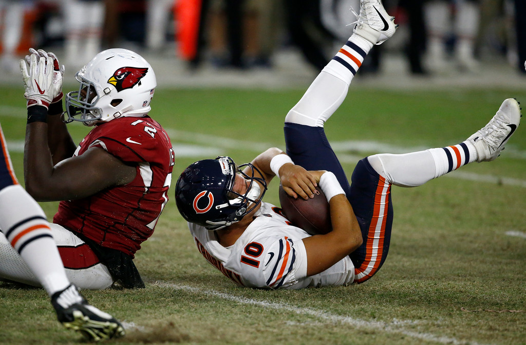 . Arizona Cardinals defensive tackle Olsen Pierre (72) celebrates his sack of Chicago Bears quarterback Mitchell Trubisky (10) during the second half of a preseason NFL football game, Saturday, Aug. 19, 2017, in Glendale, Ariz. (AP Photo/Ross D. Franklin)
