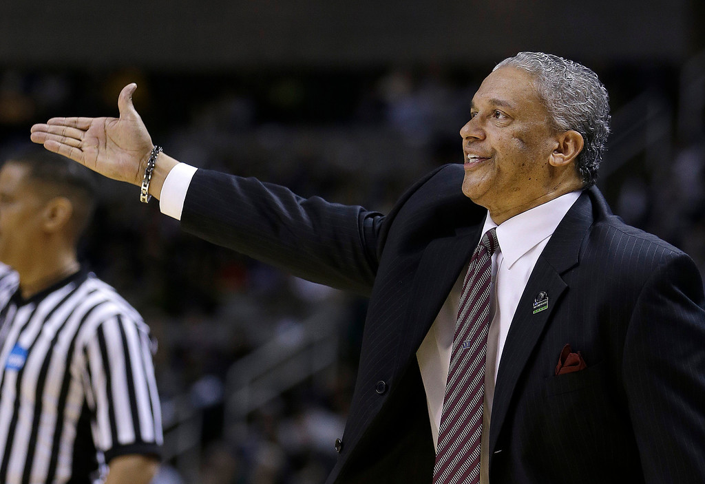 . New Mexico State head coach Marvin Menzies gestures during the first half of a second-round game in the NCAA college basketball tournament against Saint Louis in San Jose, Calif., Thursday, March 21, 2013. (AP Photo/Ben Margot)