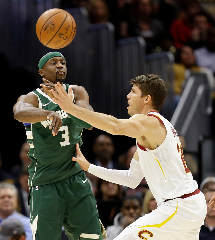 . Milwaukee Bucks\' Jason Terry (3) passes against Cleveland Cavaliers\' Kyle Korver (26) in the first half of an NBA basketball game, Tuesday, Nov. 7, 2017, in Cleveland. (AP Photo/Tony Dejak)