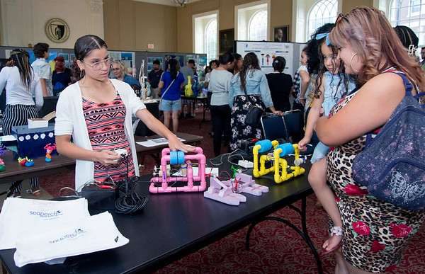 08/16/19 Wesley Bunnell | Staff TRIO, a two week long summer program run by CCSU in science and arts held their closing ceremony on Friday August 16, 2019 at Founders Hall at CCSU. Jazmarie Santiago, a rising 8th grade student at Pulaski Middle School, demonstrates her underwater robotics project to her mother Wilmarys Colon.