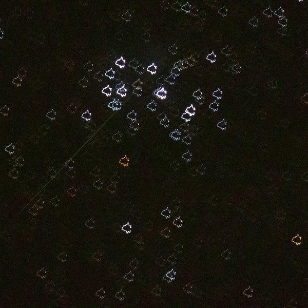 Abstract M45 Pleiades, with a satellite trail