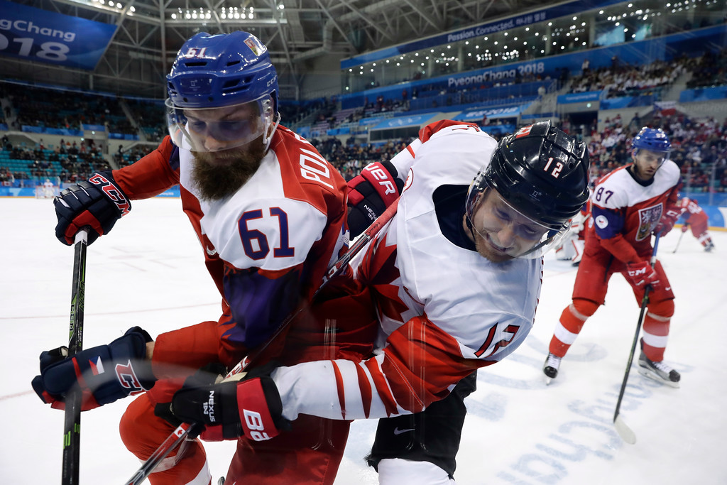 . Adam Polasek (61), of the Czech Republic, and Rob Klinkhammer (12), of Canada, battle for the puck during the third period of the men\'s bronze medal hockey game at the 2018 Winter Olympics in Gangneung, South Korea, Saturday, Feb. 24, 2018. (AP Photo/Matt Slocum)