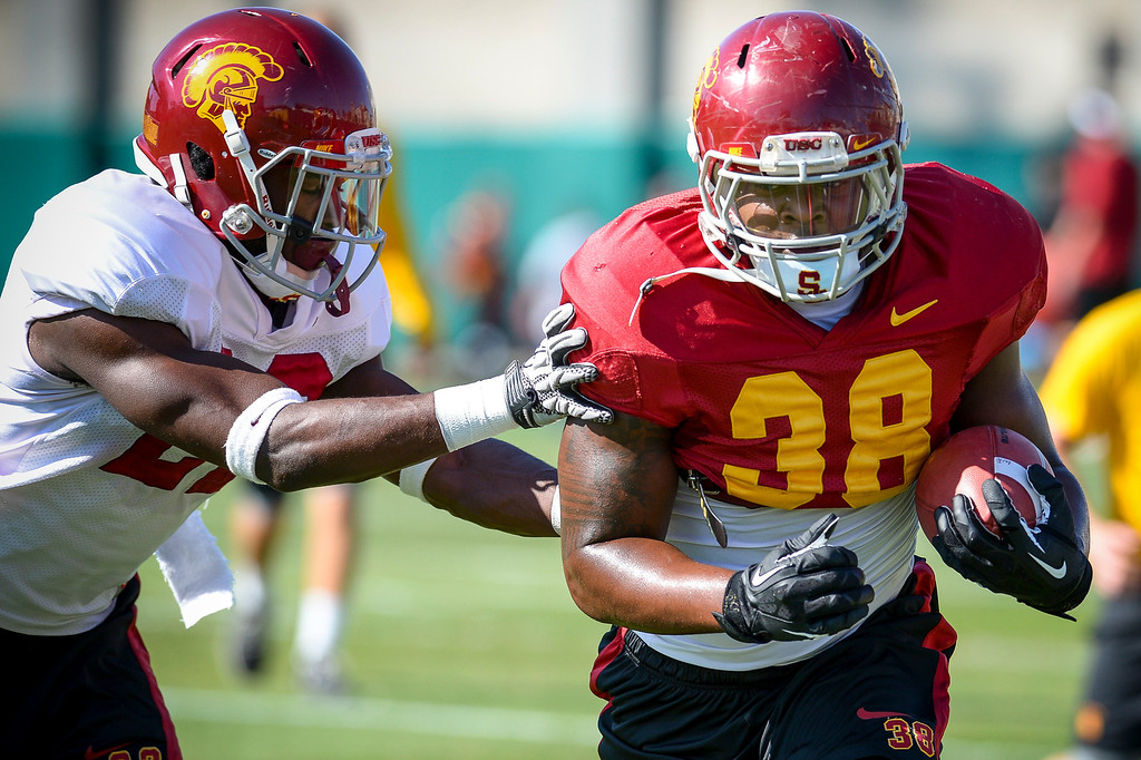 . USC�s Jahleel Pinner runs the ball past Leon McQuay III during spring practice at USC Tuesday, April 15, 2014.  (Photo by David Crane/Los Angeles Daily News.)