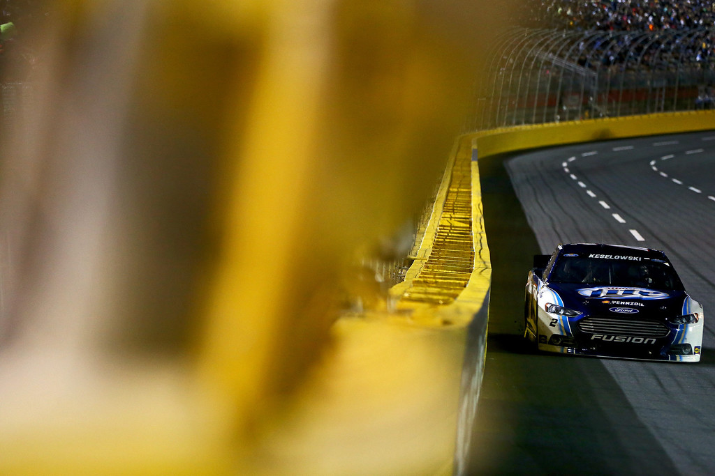 . CONCORD, NC - OCTOBER 12:  Brad Keselowski, driver of the #2 Miller Lite Ford, races the NASCAR Sprint Cup Series Bank of America 500 at Charlotte Motor Speedway on October 12, 2013 in Concord, North Carolina.  (Photo by Jonathan Ferrey/Getty Images)