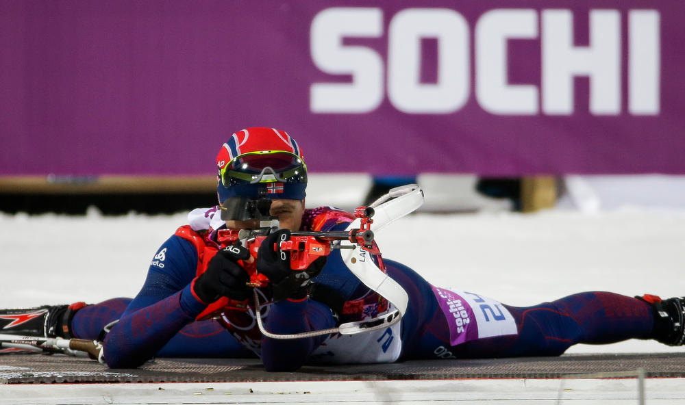 . Norway\'s Ole Einar Bjoerndalen shoots on his way to win the gold medal in the men\'s biathlon 10k sprint, at the 2014 Winter Olympics, Saturday, Feb. 8, 2014, in Krasnaya Polyana, Russia. (AP Photo/Gero Breloer)