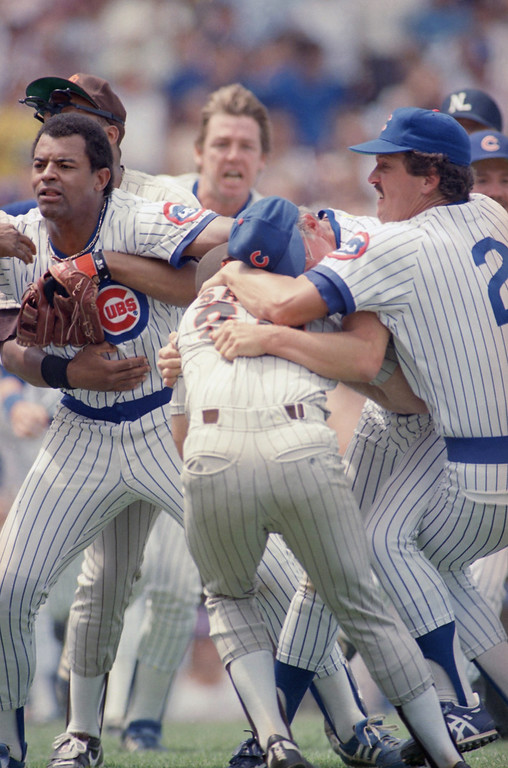 . As Cubs Ron Davis, center right, struggle with Padres Eric Show, center, teammates Leon Durham, left, and Ed Lynch, center, behind, and third base coach John Vukovich, right, get involved in a bench-clearing brawl after Cubs Andre Dawson was hit in the face with a pitch by Eric Show during the third inning, Tuesday, July 7, 1987, Chicago, Ill. (AP Photo/John Swart)