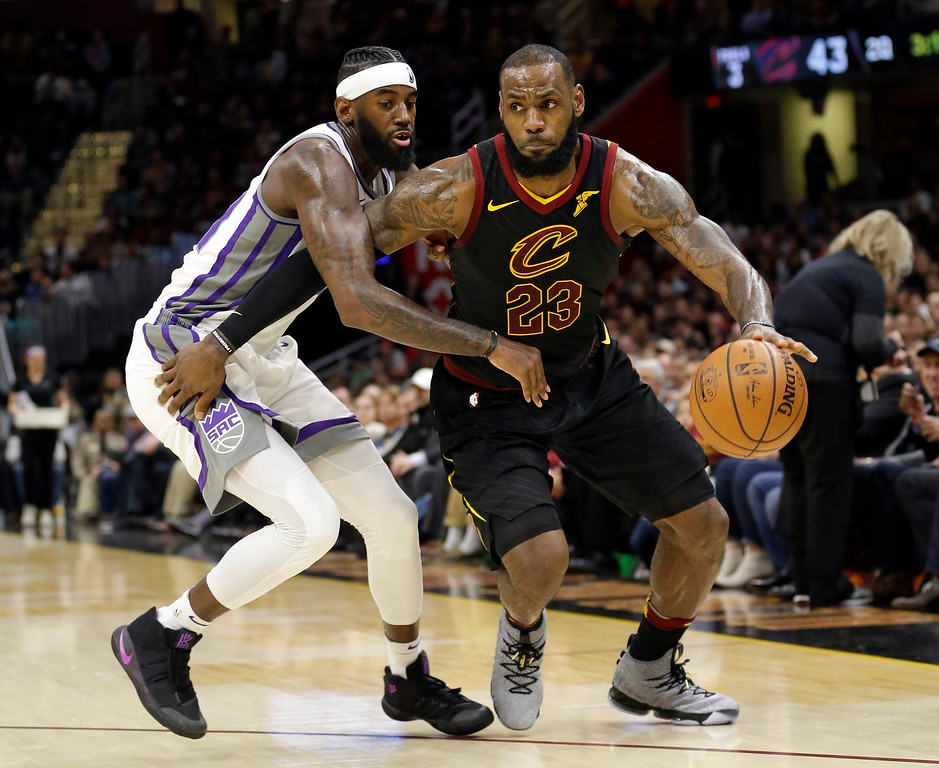 . Cleveland Cavaliers\' LeBron James, right, drives against Sacramento Kings\' JaKarr Sampson in the first half of an NBA basketball game, Wednesday, Dec. 6, 2017, in Cleveland. (AP Photo/Tony Dejak)