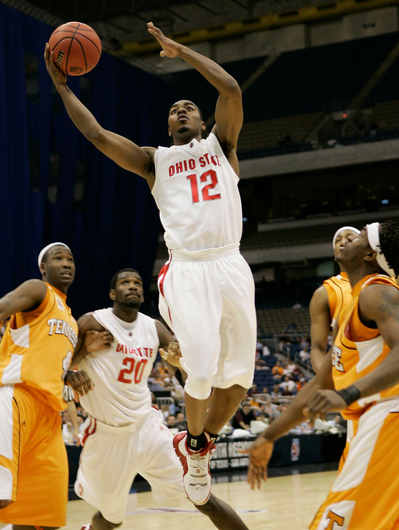. Ohio State\'s Ron Lewis (12) shoots over the Tennessee defense in the second half of an 85-84 win in their NCAA South Regional semifinal basketball game at the Alamodome in San Antonio, Thursday, March 22, 2007.  Lewis was the game\'s high-scorer with 25 points. (AP Photo/David J. Phillip)