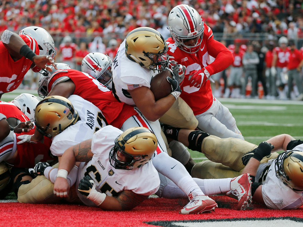 . Army running back Darnell Woolfolk, center, scores a touchdown against Ohio State during the first half of an NCAA college football game Saturday, Sept. 16, 2017, in Columbus, Ohio. (AP Photo/Jay LaPrete)