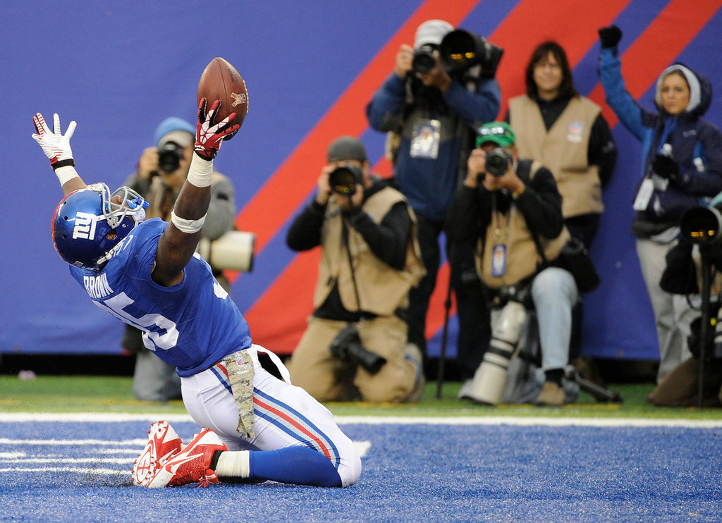 . New York Giants running back Andre Brown celebrates after scoring a touchdown against the Oakland Raiders during the second half of an NFL football game, Sunday, Nov. 10, 2013, in East Rutherford, N.J. (AP Photo/Bill Kostroun)