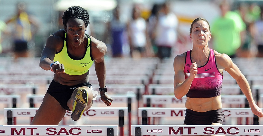 . Yvette Lewis, left, of Brooks wins the 100 meter hurdles invitational elite as Jessica Zelinka of NYAC Nike finished third during the Mt. SAC Relays in Hilmer Lodge Stadium on the campus of Mt. San Antonio College on Saturday, April 20, 2012 in Walnut, Calif.    (Keith Birmingham/Pasadena Star-News)