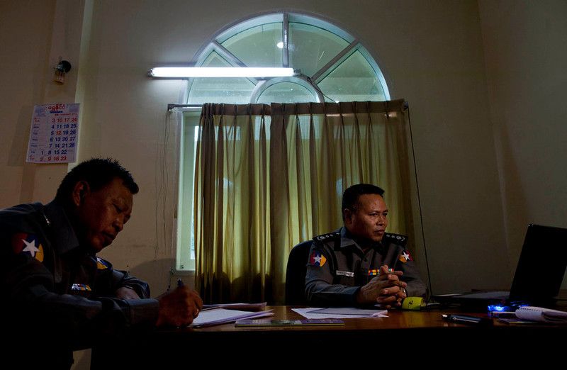 . Police Col. Myint Thein, right, head of the Central Committee for Drug Abuse and Control which controls the country\'s drug policy, and police officer Majo Zaw Min Oo sit in an office in Yangon, Myanmar on Feb 25, 2013. Far from Myanmar\'s postcard-perfect pagodas and colonial relics, the remote mountain villages of southern Shan State do not appear on maps of Myanmar or in any guide books. In obscurity, they have been ground zero for Myanmar\'s drug trade which has thrived on poverty and corruption. (AP Photo/Gemunu Amarasinghe)