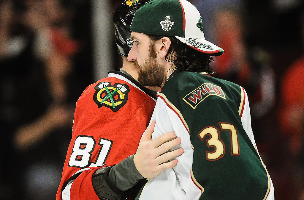 . After the game Minnesota goalie Josh Harding is greeted by Chicago\'s Marian Hossa who scored two goals him. (Pioneer Press: Ben Garvin)