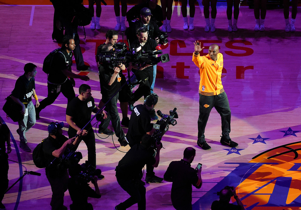 . Los Angeles Lakers forward Kobe Bryant waves to the crowd during a ceremony before Bryant\'s last NBA basketball game, against the Utah Jazz, Wednesday, April 13, 2016, in Los Angeles. (AP Photo/Mark J. Terrill)