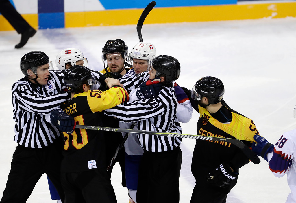 . Referees break up a fight between =g50 and Tommy Kristiansen (15), of Norway, during the second period of the preliminary round of the men\'s hockey game at the 2018 Winter Olympics in Gangneung, South Korea, Sunday, Feb. 18, 2018. (AP Photo/Matt Slocum)