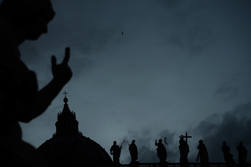 . Silhouettes of statues on St Peter\'s square during the conclave on March 12, 2013 at the Vatican. Cardinals moved into the Vatican today as the suspense mounted ahead of a secret papal election with no clear frontrunner to steer the Catholic world through troubled waters after Benedict XVI\'s historic resignation.  AFP PHOTO / FILIPPO MONTEFORTE/AFP/Getty Images