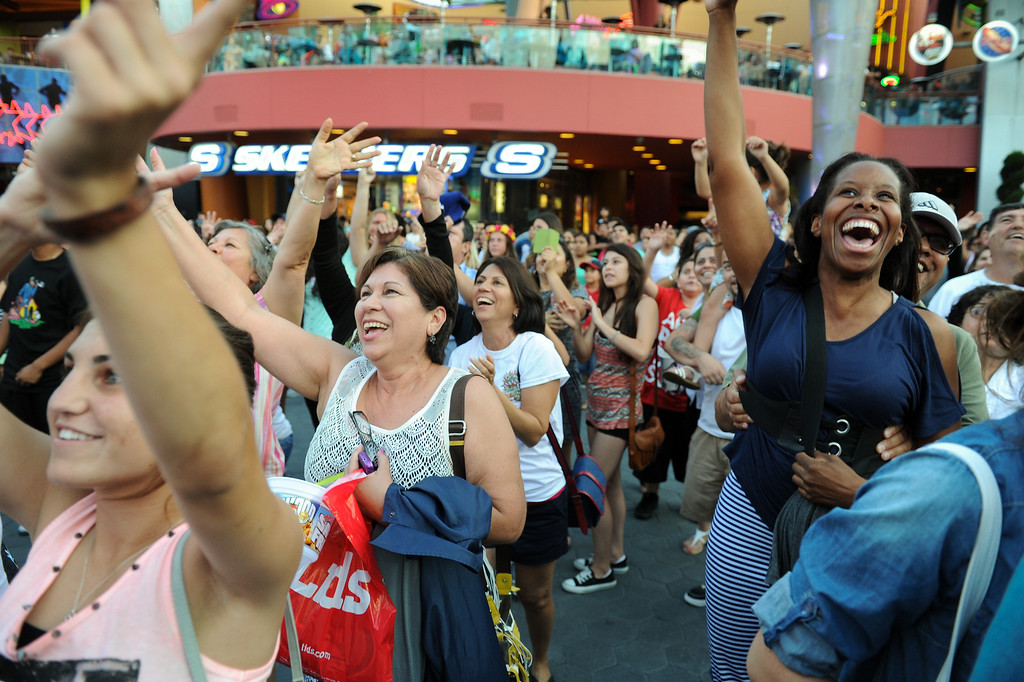 . People cheer their faces on the video screen during a DJ performance at 5 Towers at Universal CityWalk. Friday, July 6, 2013. (Michael Owen Baker/L.A. Daily News)