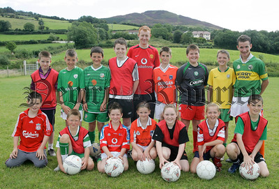 Pictured are participants aged 10 years and upwards of a coaching course organised by Camlough Rovers with their coach Barry Mooney.