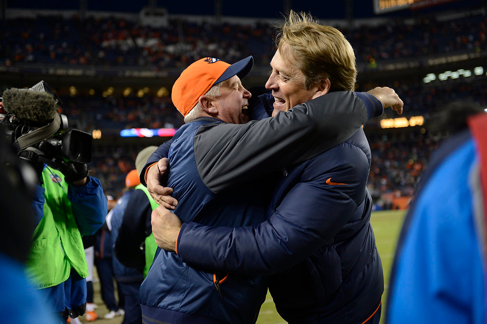 Description of . Denver Broncos head coach John Fox gets a hug from defensive coordinator Jack Del Rio as the Denver Broncos took on the Kansas City Chiefs at Sports Authority Field at Mile High in Denver, Colorado on December 30, 2012. Joe Amon, The Denver Post