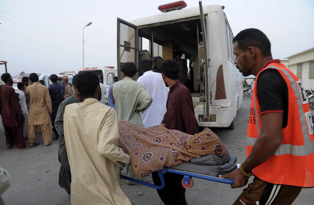 . Injured Pakistani earthquake survivors are shifted by relatives to an ambulance in the devastated district of Awaran on September 28, 2013. A powerful 6.8-magnitude earthquake hit southwest Pakistan, killing at least 22 people in a region already devastated by a tremor which left more than 300 people dead this week, local officials said. BANARAS KHAN/AFP/Getty Images